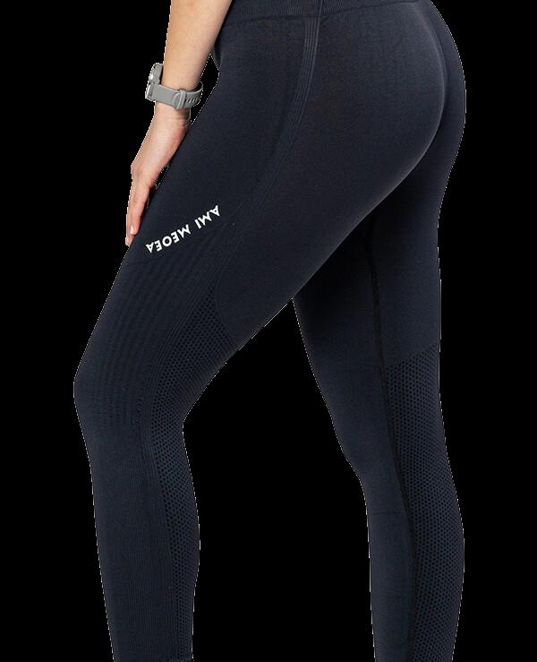 Športne pajkice za ženske Ami– temno sive, raztegljive, fleksibilne, brezšivne legice s topkom. Bogata izbira materialov in barv. Leona legice – najboljša ponudba pajkic.